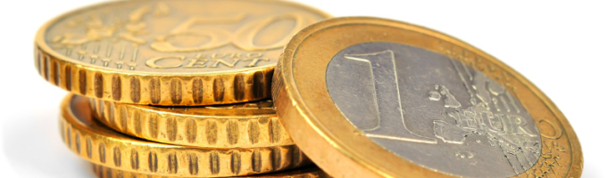 Stacks of gold euro coins on a white background